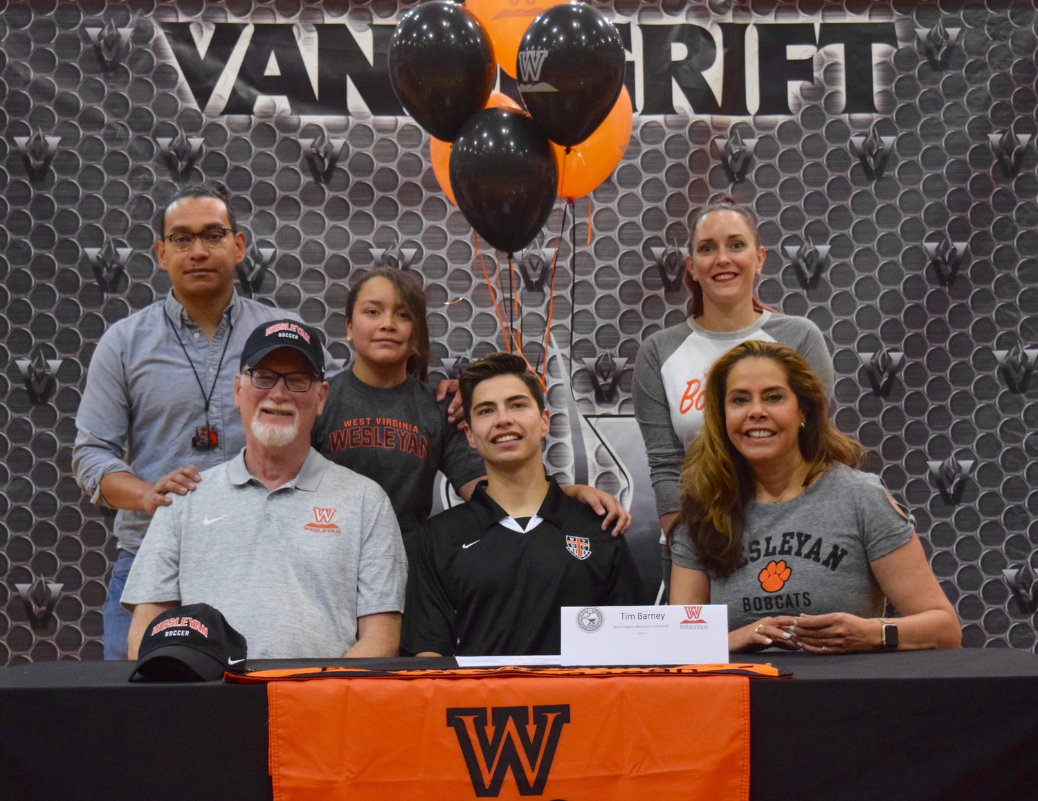 Tim Barney signed on to play soccer at Westw Virginia Wesleyan College at a signing day celebration Friday morning at Vandegrift High School.