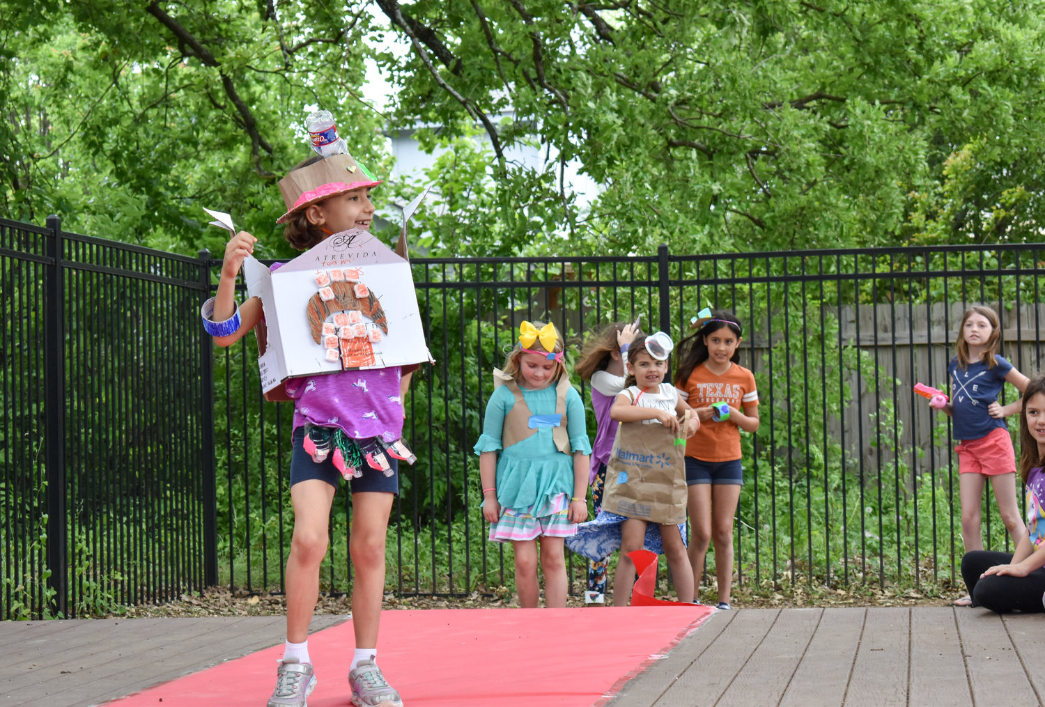 Julianna Fontaine, age 7, walks the runway during the 9th Annual Root for Earth campaign at The Goddard School in Cedar Park on Monday, April 22, 2019.