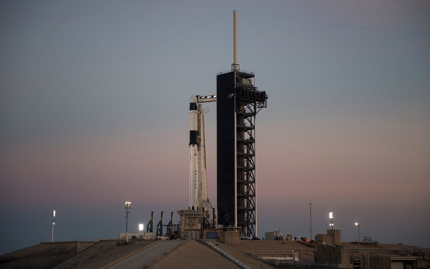 A SpaceX Falcon 9 rocket with the company's Crew Dragon spacecraft onboard is seen after being raised into a vertical position on the launch pad at Launch Complex 39A as preparations continue for the Demo-1 mission, February 28 2019 at the Kennedy Space Center in Florida.The rockets launched from Michigan would be smaller in size than the reusable Falcon 9 rockets made by SpaceX. They also would orbit Earth at the Poles, rather than around the equator.
