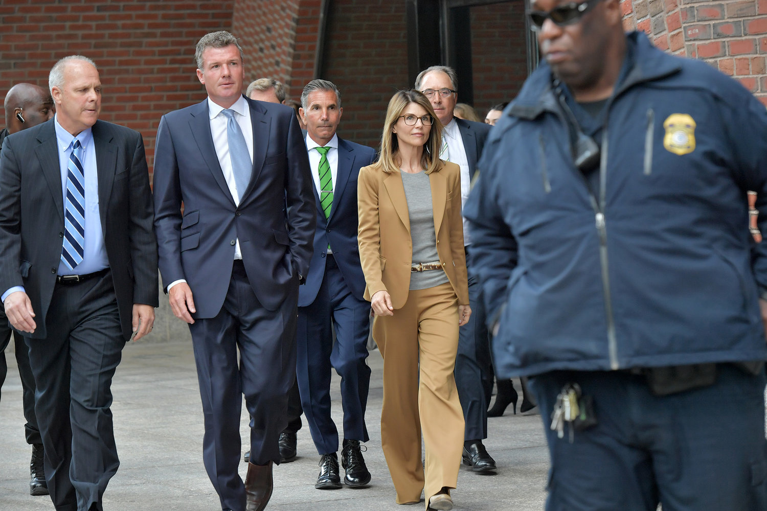 Lori Loughlin exits the John Joseph Moakley U.S. Courthouse after appearing in Federal Court to answer charges stemming from college admissions scandal on April 3, 2019 in Boston, Mass.