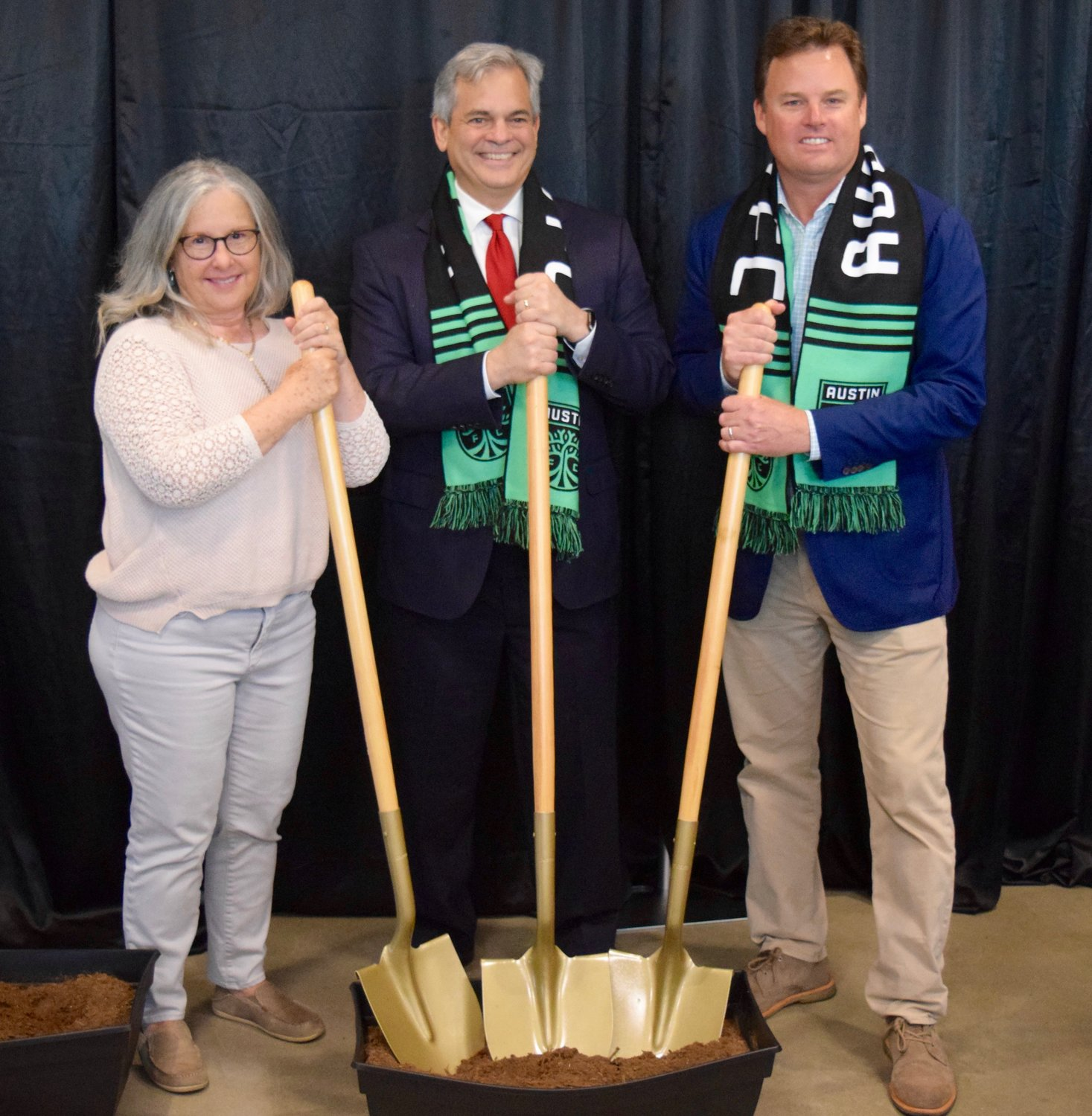 Austin City Councilmember Leslie Pool, Mayor Steve Adler and Austin FC chairman and CEO Anthony Precourt at a ceremonial groundbreaking for the newest affordable housing development last week.