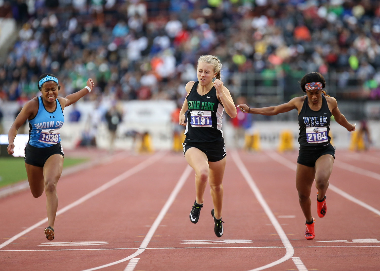 Meghan Wilcox of Cedar Park High School crosses the finish line third for a bronze medal in the Class 5A girls 100-meter dash at the UIL State Track and Field Meet on Friday, May 10, 2019 at Mike A. Myers Stadium in Austin, Texas.