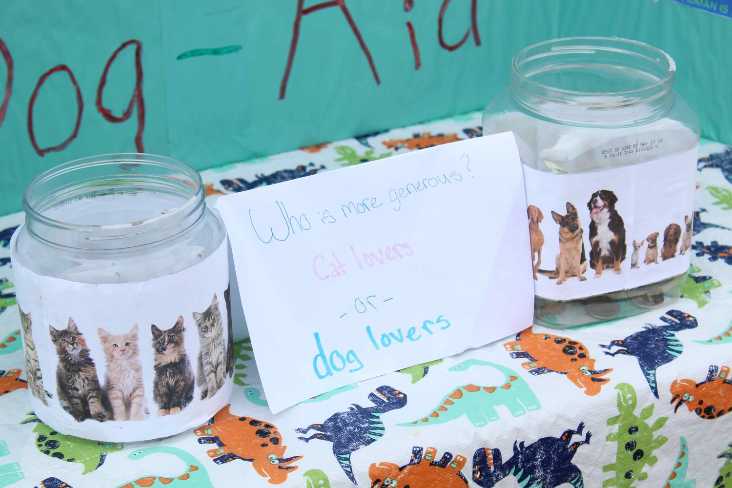 Tip jars at Myah Kapavik's lemonade stand were split between dog and cat lovers to see who is more generous. Cat tippers beat dog tippers in a close race during Lemonade Day on Saturday.