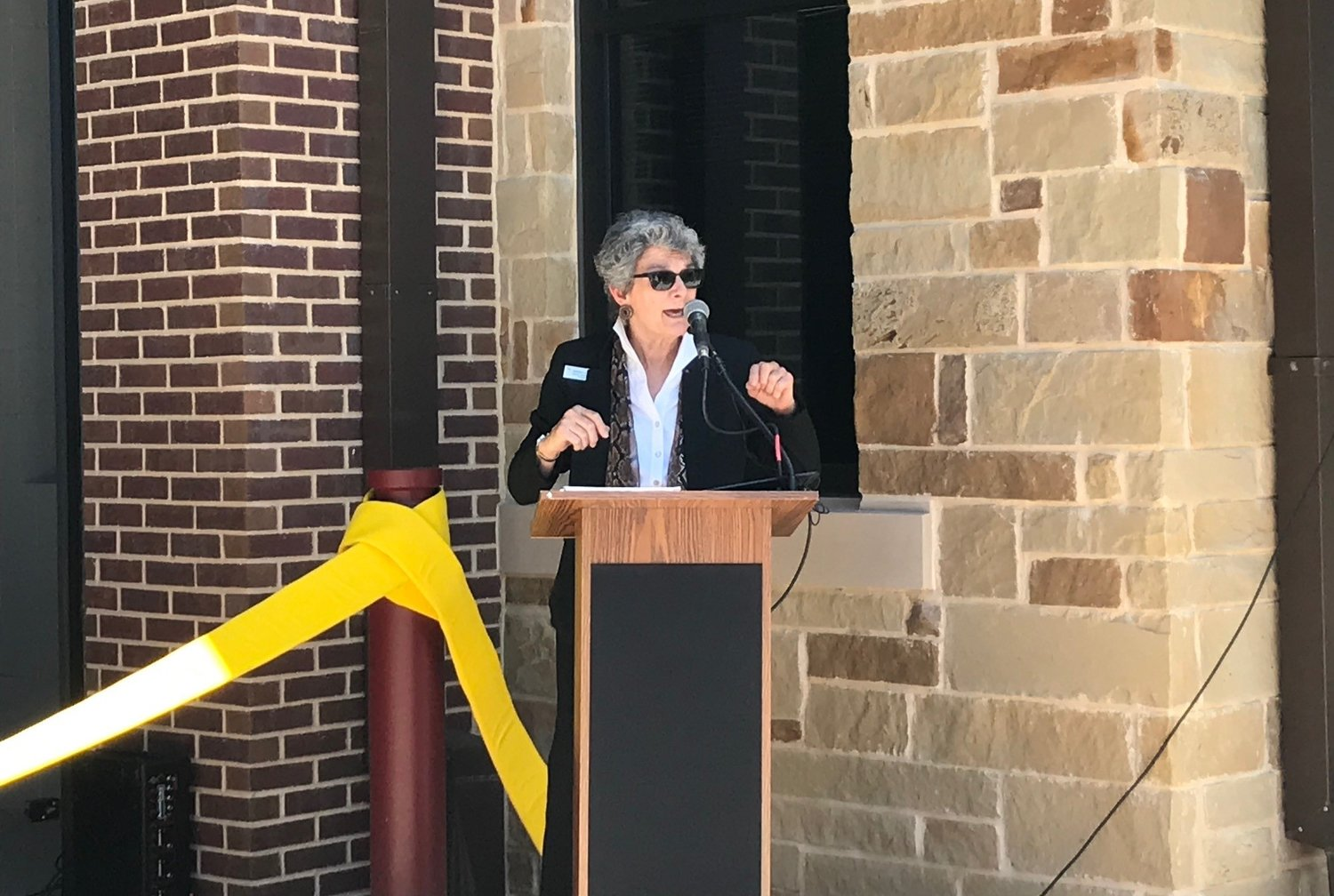 Commissioner Terry Cook speaks during the grand opening of the Sam Bass Fire Station 3 in Round Rock during a grand opening ceremony on May 16, 2019.