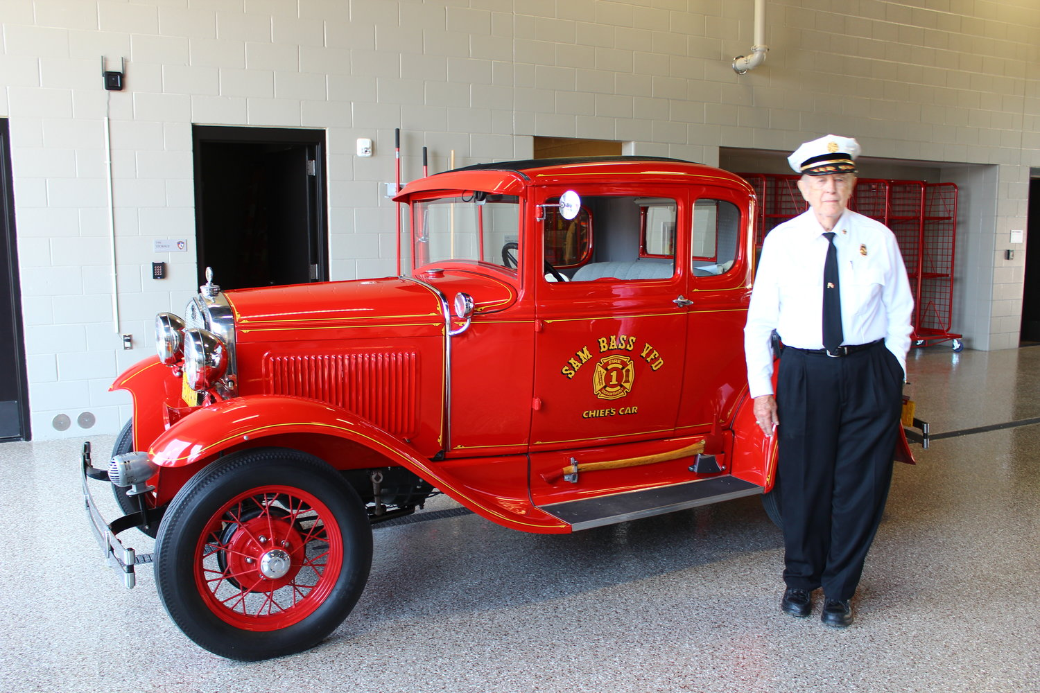 Former Sam Bass Fire Chief Bob Steinman poses with his car during during the grand opening of the Sam Bass Fire Station 3 in Round Rock during a grand opening ceremony on May 16, 2019.