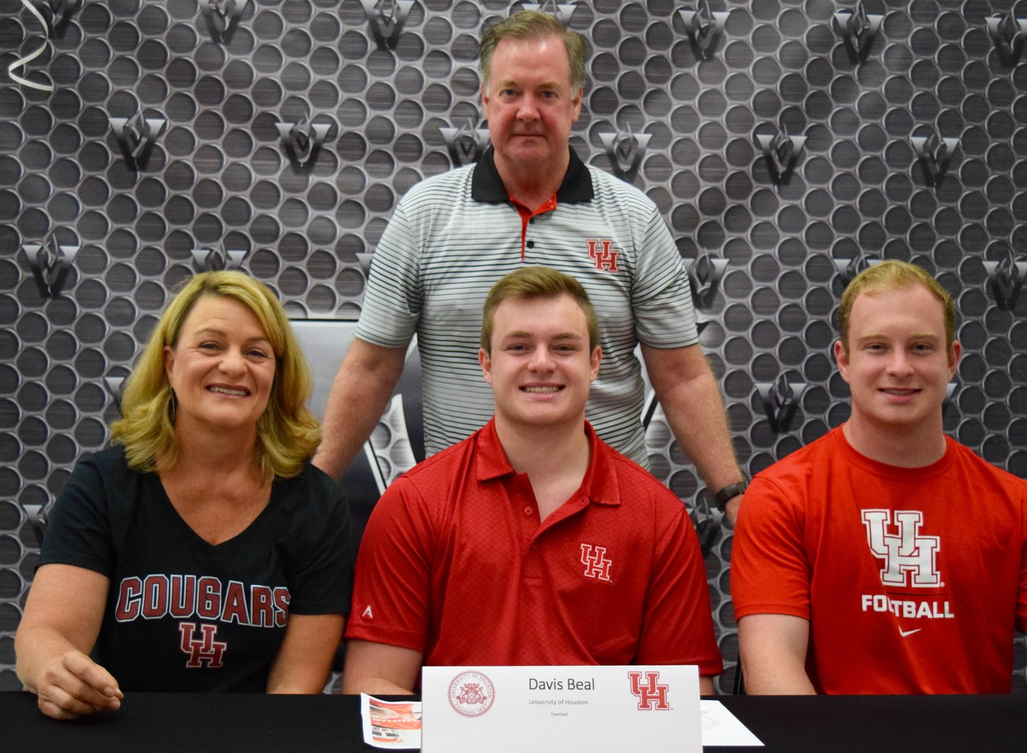 Davis Beal signed to play football at Houston at a ceremony Tuesday morning at Vandegrift High School.