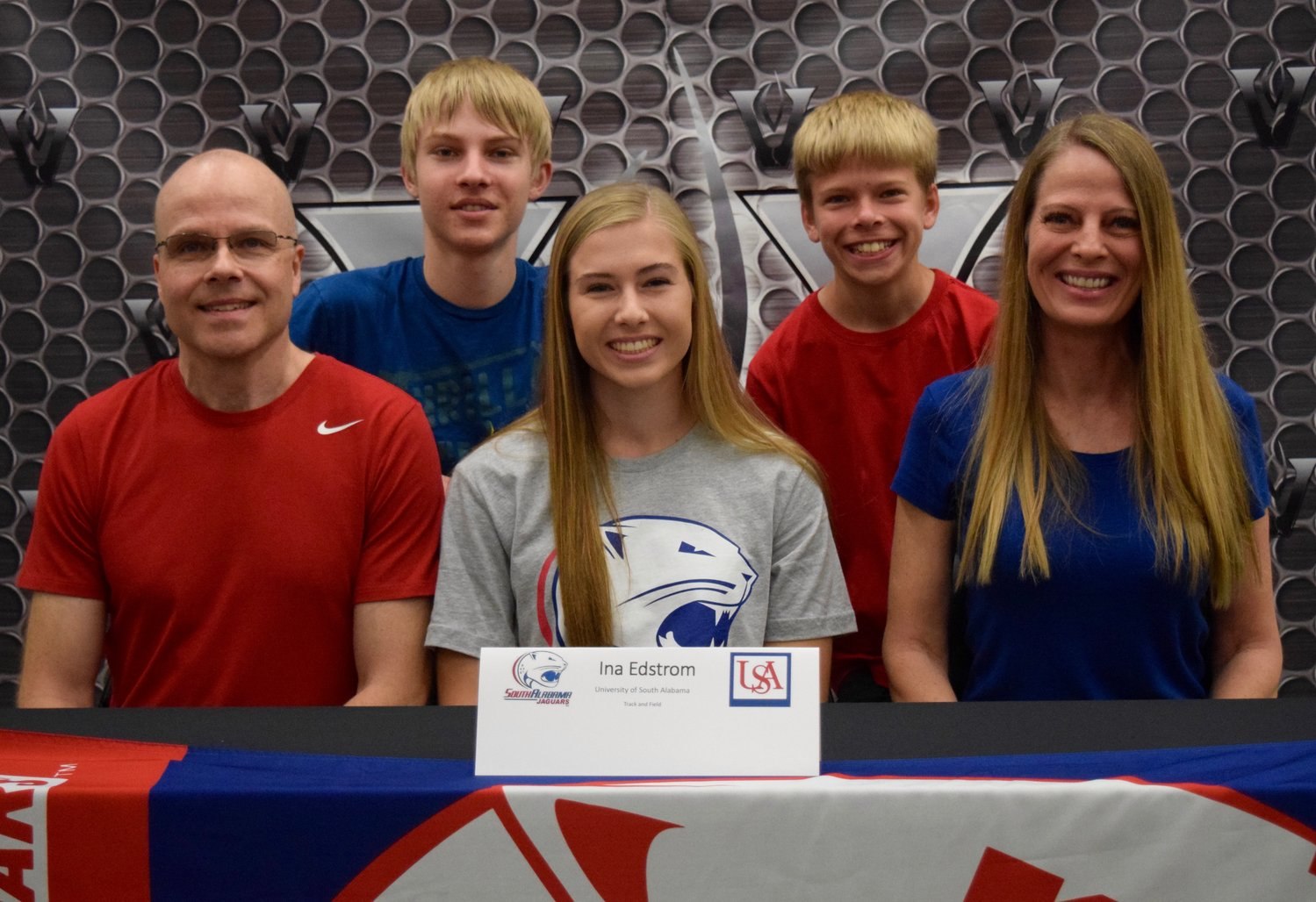 Ina Edstrom signed to compete in the pole vault at South Alabama University at a ceremony Tuesday morning at Vandegrift High School.