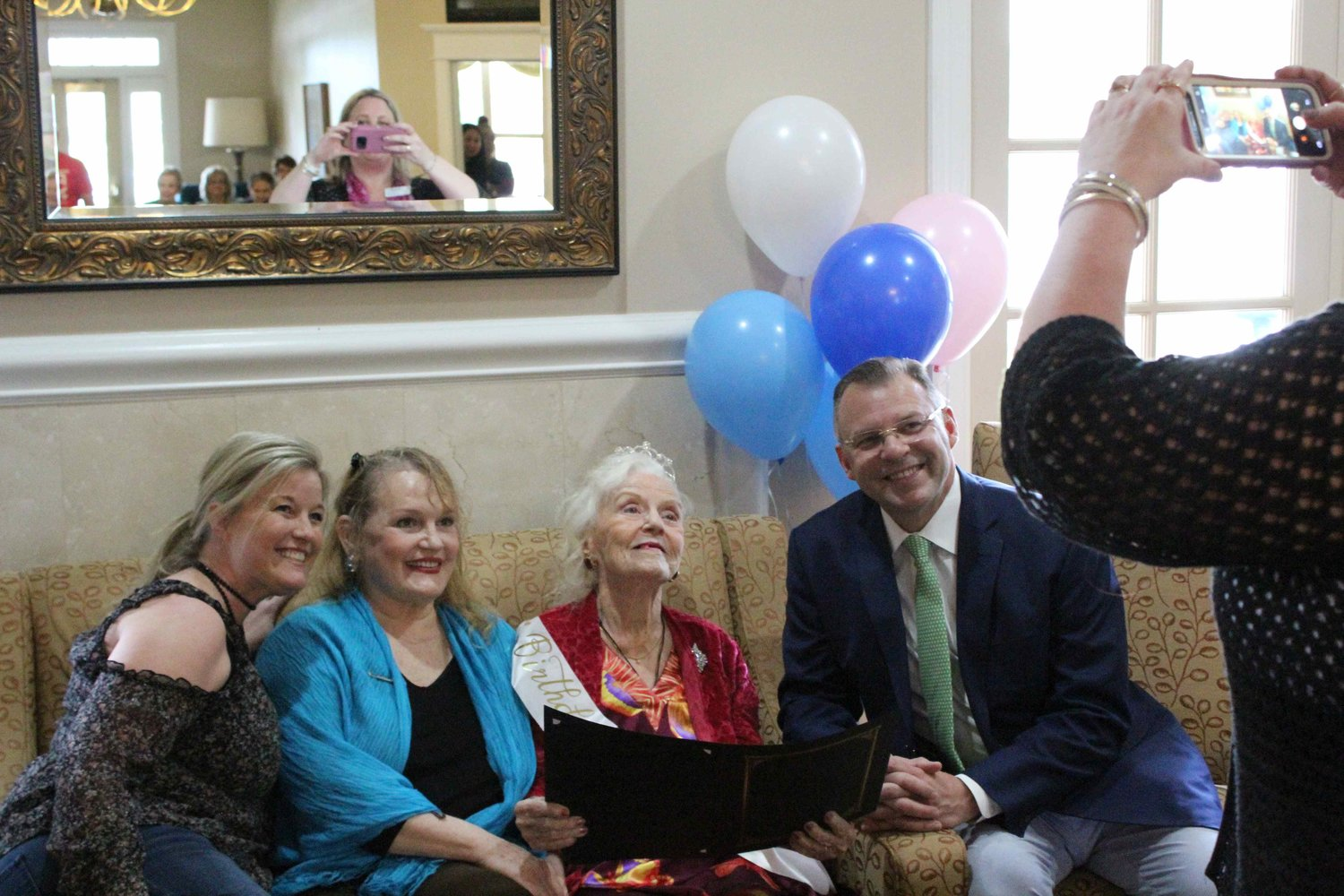 Cedar Park Mayor Corbin Van Arsdale (right), Stephanie Van Arsdale, Martha Wetherby, and her daughter Linda pose for a picture for Martha Wetherby's 102nd birthday on May 9th, 2019 at The Pointe at Cedar Park.