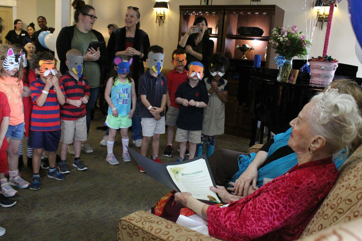 Martha Wetherby watches as kindergartners from Primrose School sing Happy birthday during her 102nd Birthday party on May 9, 2019 at The Pointe at Cedar Park.
