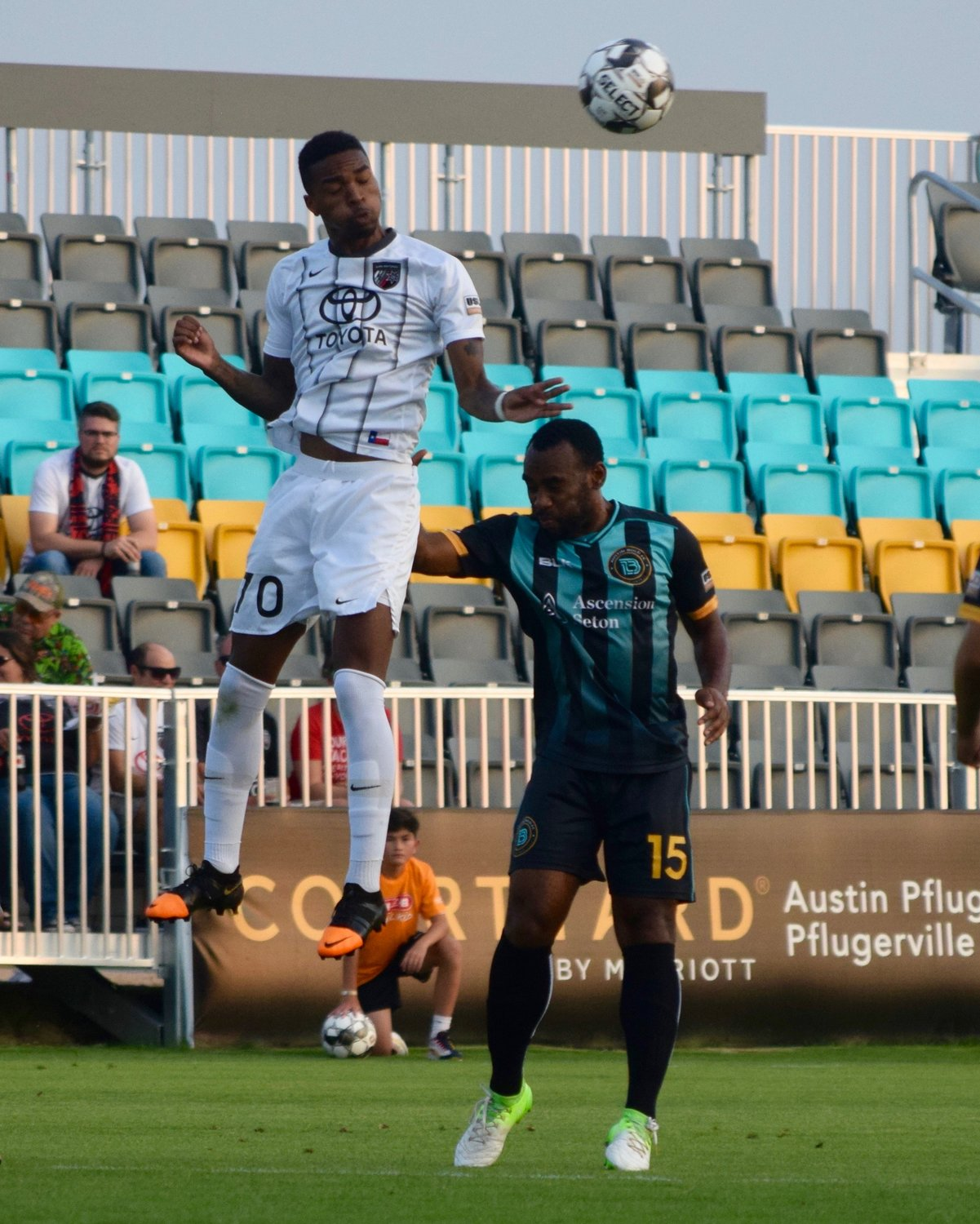 San Antonio FC forward Bradford Jamieson, left, and Austin Bold FC defender Amobi Okugo, battle for the ball during an Open Cup match on Wednesday night. Austin won 4-2.