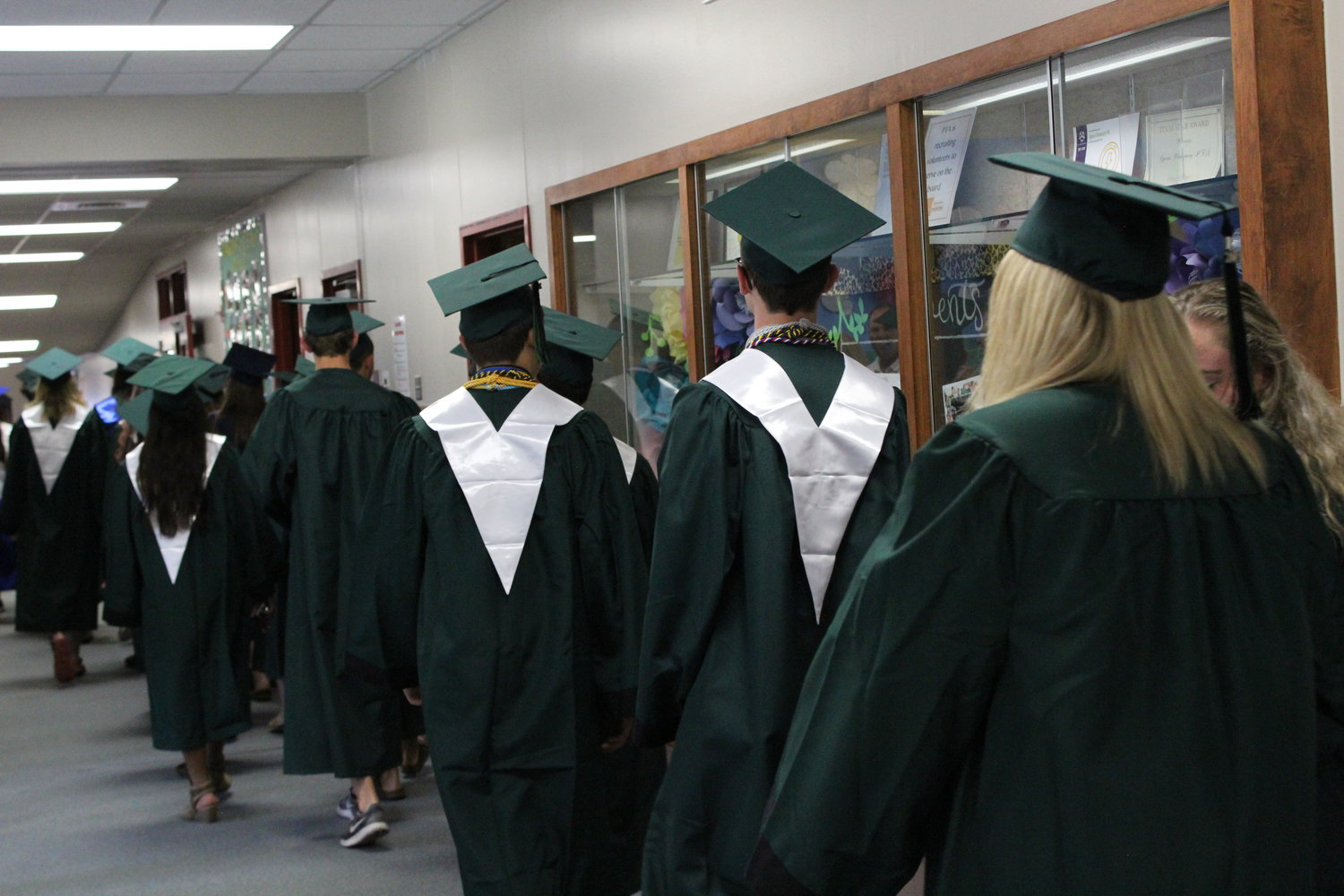 Graduating seniors from Cedar Park High School begin their walk to high-five Cypress Elementary School students on May 29, 2019.