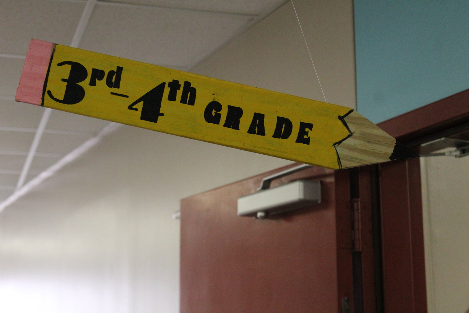 A sign on the second floor of Cypress Elementary School displays the grades of students in the hallway during a 'senior walk' in which the students high-five graduating seniors from Cedar Park High School on May 29, 2019.