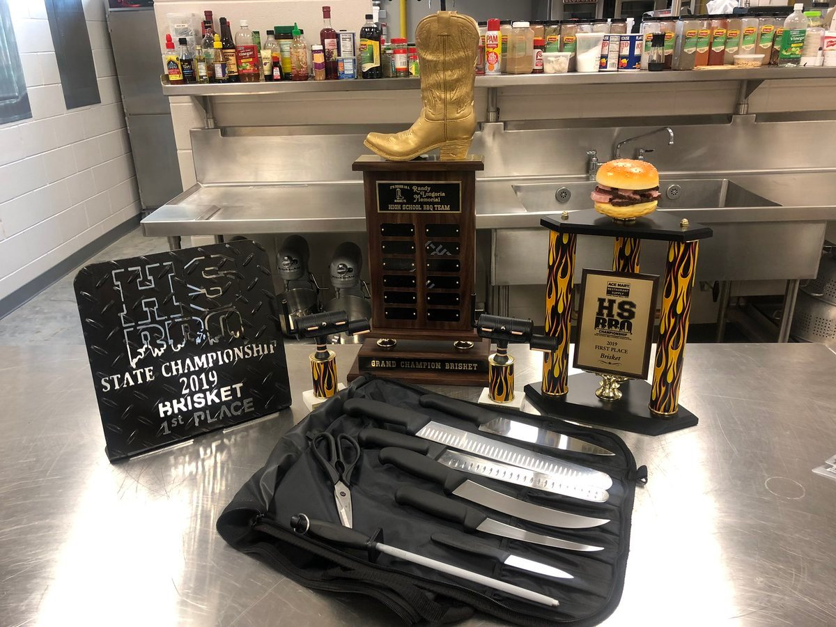 The team's trophies and the set of knives they used during the State High School BBQ Championship on May 4, 2019.
