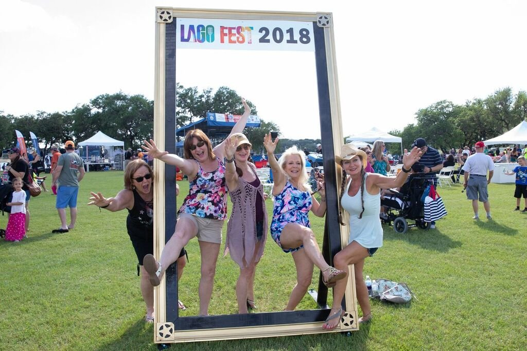 Attendees to last year's LagoFest pose in a picture frame at the event on May 5, 2018.