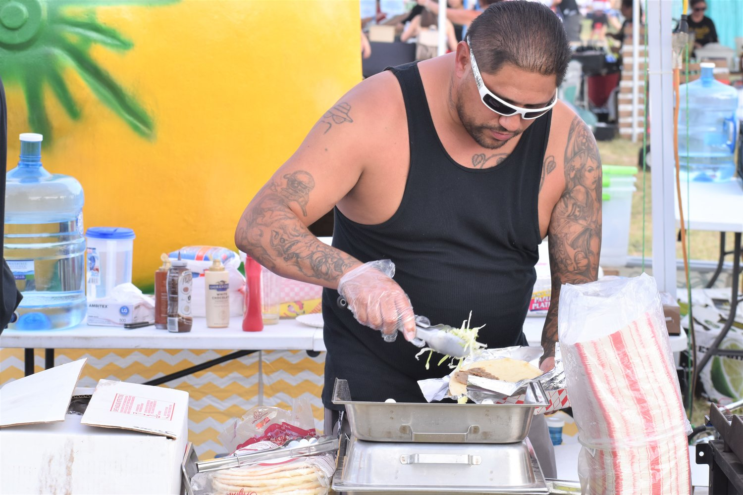 Rocky Ramirez, of the RJ Roasting booth, prepares a gyro for attendees at Liberty Fest in Leander on Thursday.