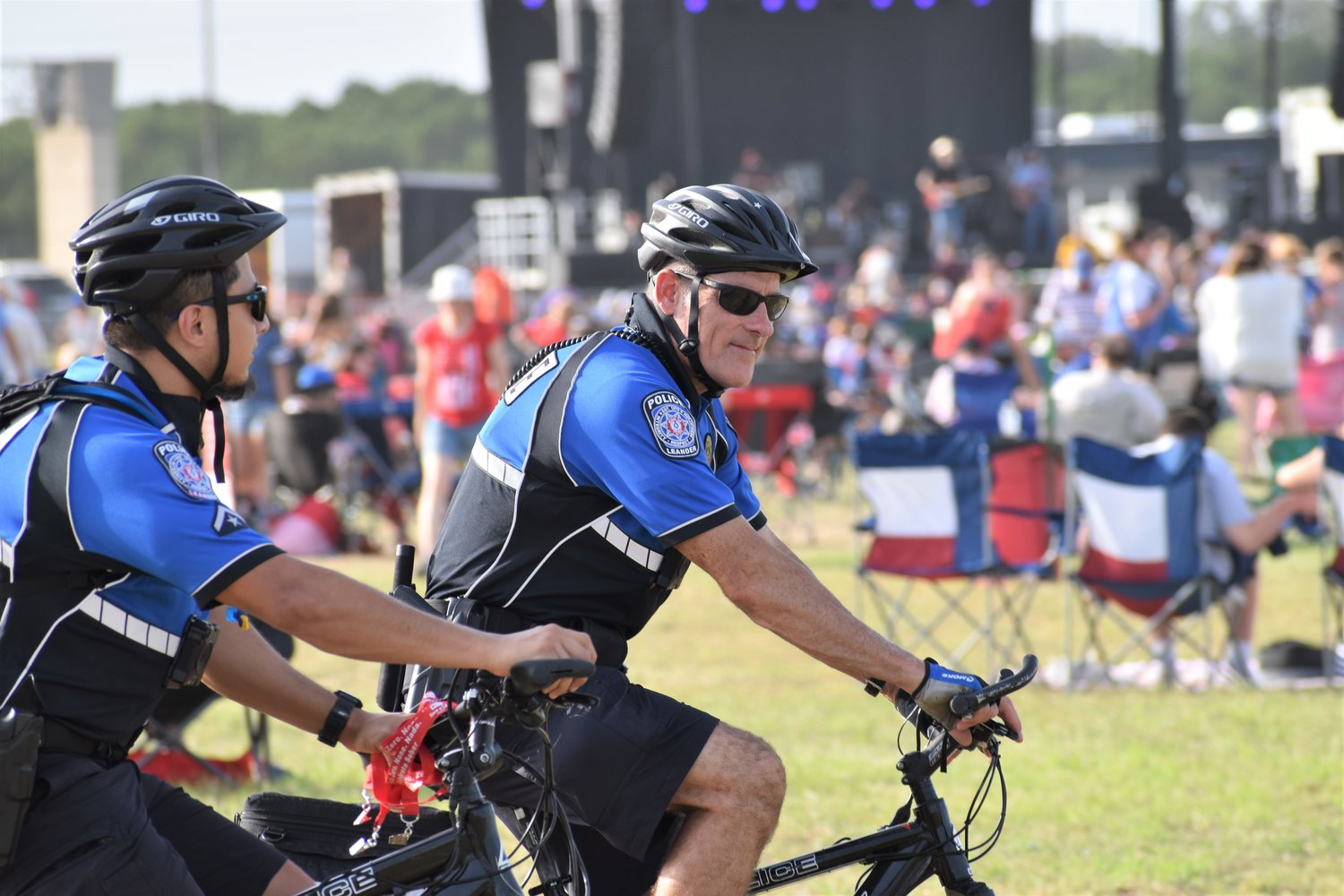 Police officers ride around the festival grounds on bicycles during Liberty Fest in Leander on Thursday.