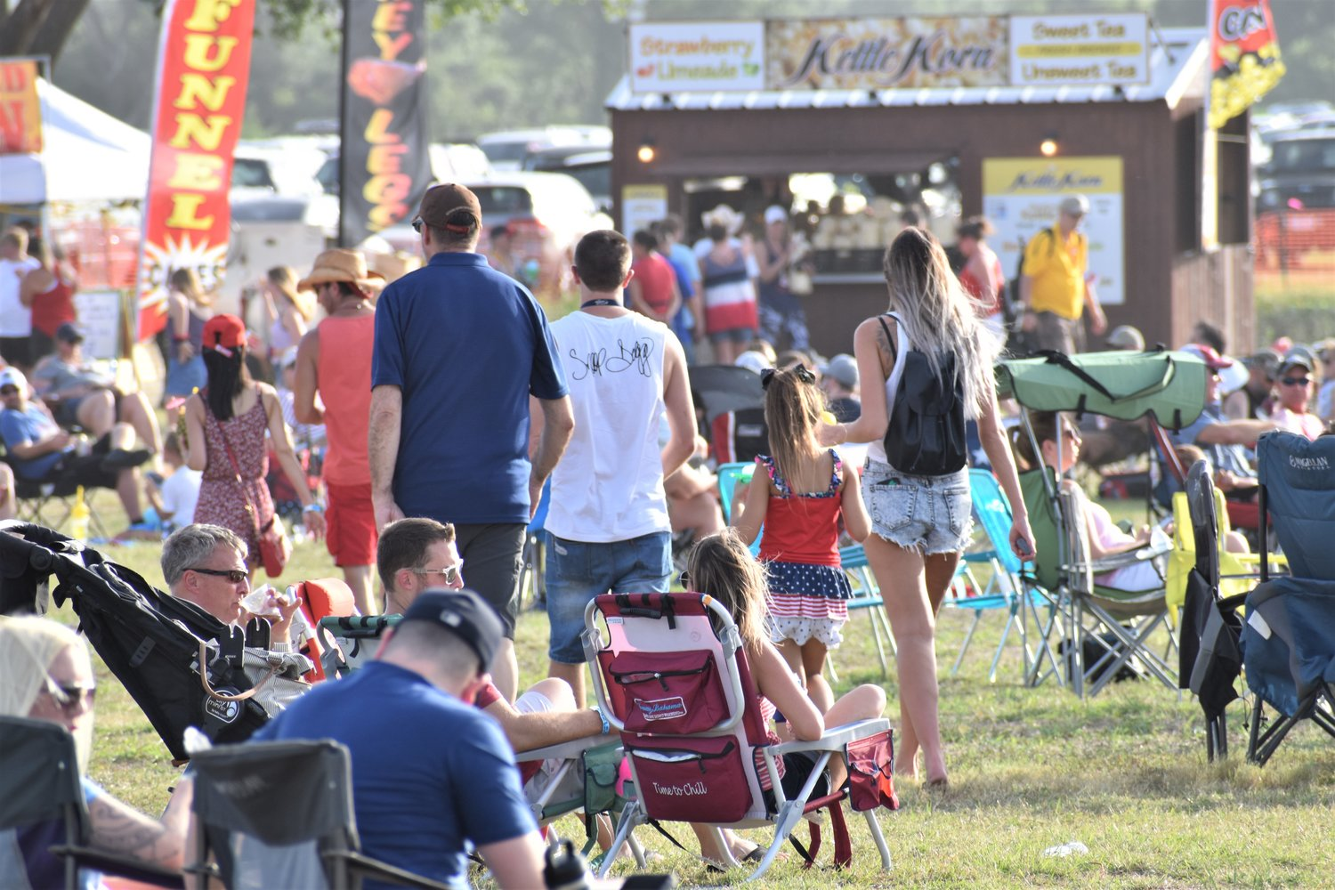 Attendees set up lawn chairs and blankets nearby the food vendors at Liberty Fest in Leander on Thursday.