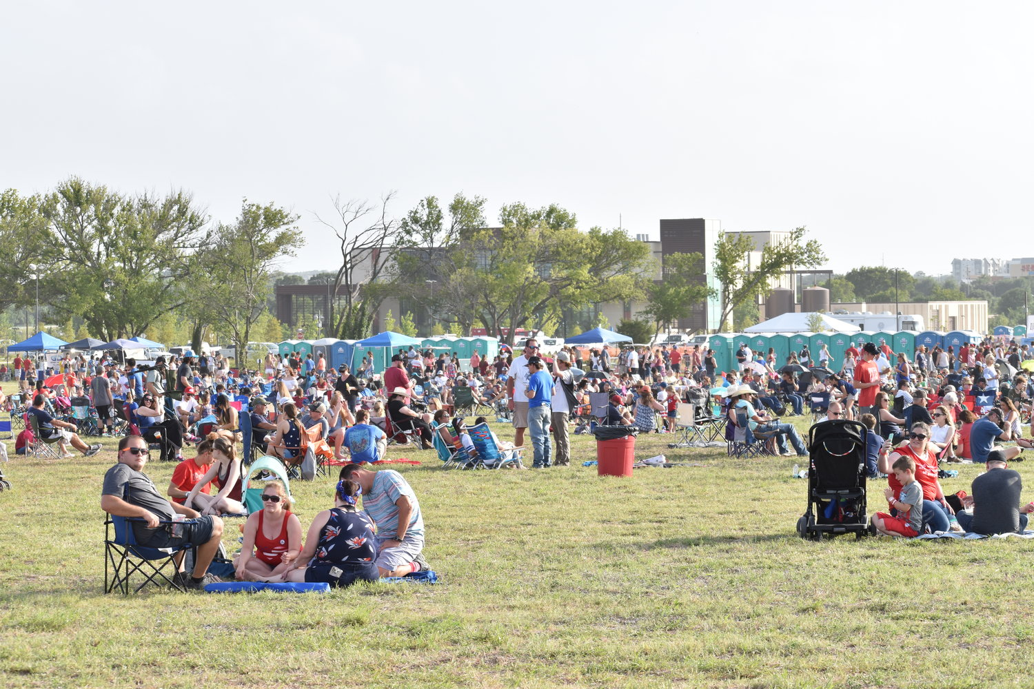 Attendees set up across the field nearby ACC San Gabriel Campus at Liberty Fest in Leander on Thursday.