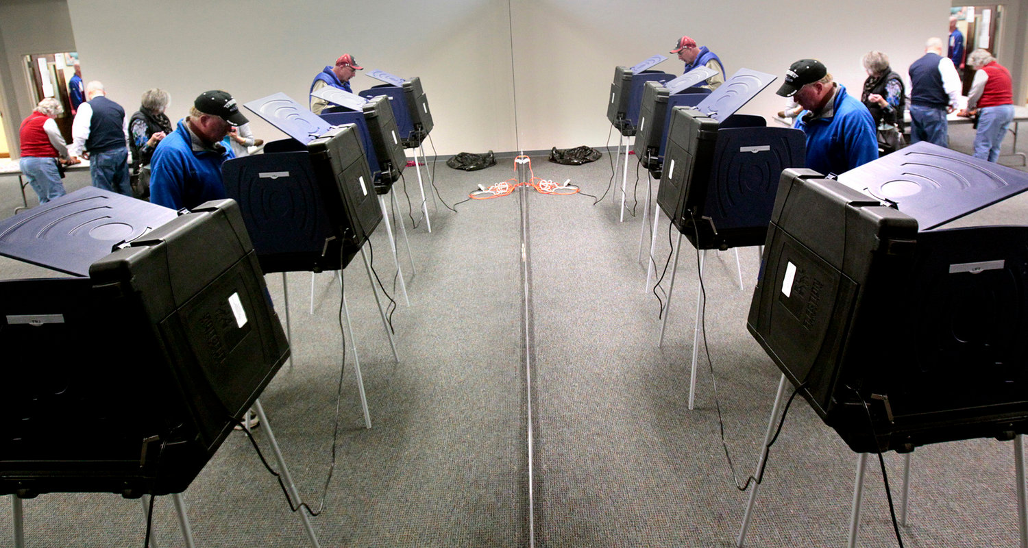 Voters cast their vote in Lexington, S.C., on Jan. 21, 2012. That state recently passed an election security measure that would require voting systems to use backup paper ballots in federal contests.
