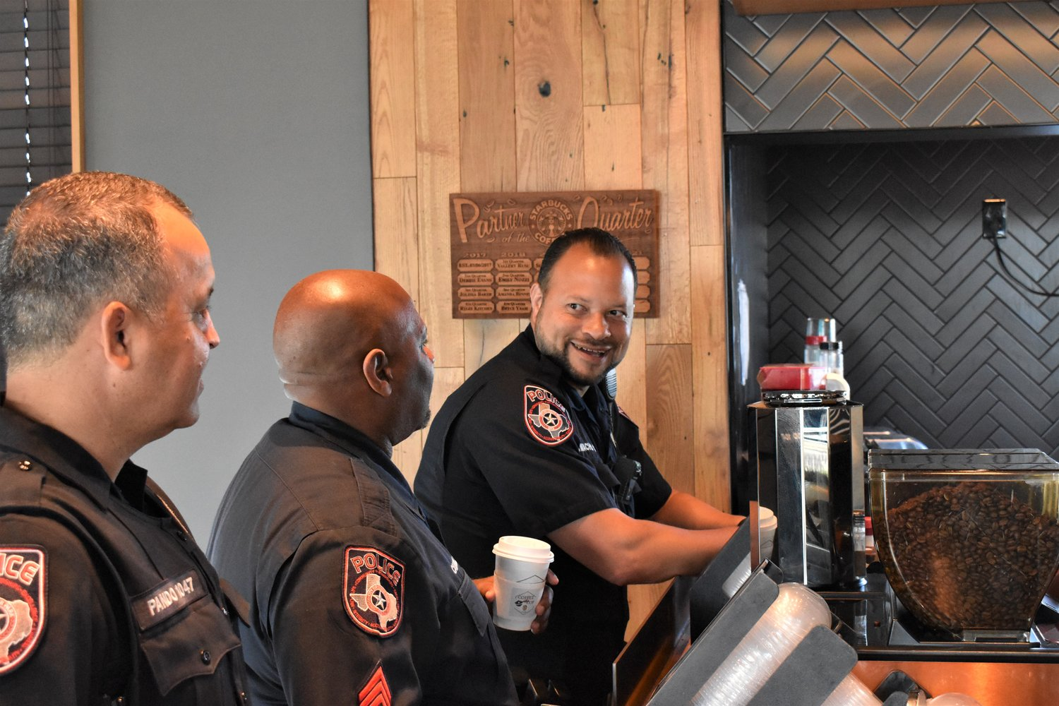 Cedar Park police officer David Camacho chats with Sgt. Jessie Campbell and Corporal Ricky Pando near the front counter as the Coffee With A Cop event winds down.