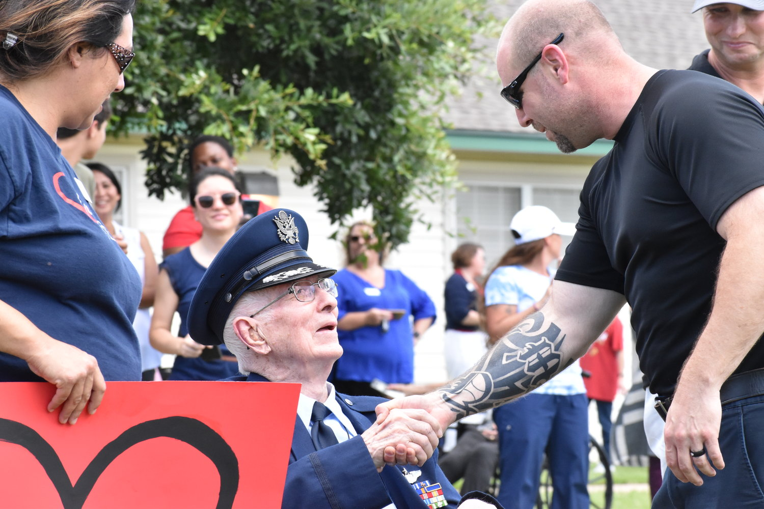 Lt. Col. Jerry Jennings shakes the hand of Nick Baker, a medic who works for Honor Flight Austin, a non-profit that aims to transport veterans to Washington D.C. to allow them to visit memorials created to honor their service.
