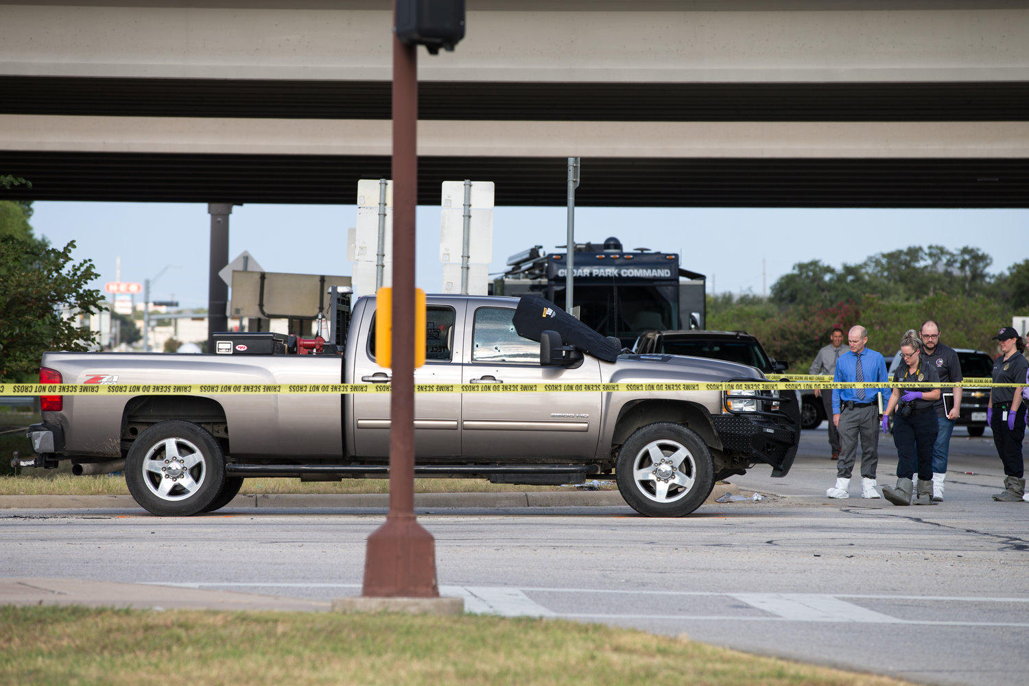 Crime scene investigators work the scene where police say someone shot  into a vehicle around 6 a.m. Saturday, August 3, 2019, killing one person and seriously injuring another, at the intersection of 183A Toll and East Whitestone Boulevard in Cedar Park.
