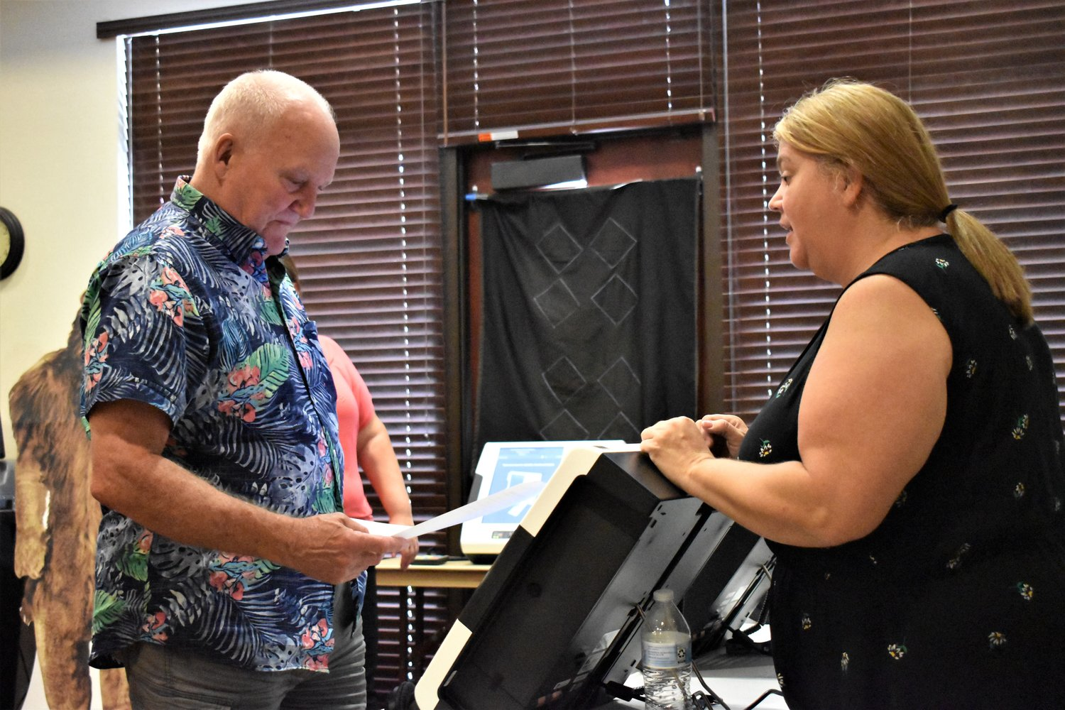 Joe Reedholm, who lost a race for the District 4 Georgetown City Council seat against  Steve Fought in May this year, tries out new voting machines purchased by Williamson County.