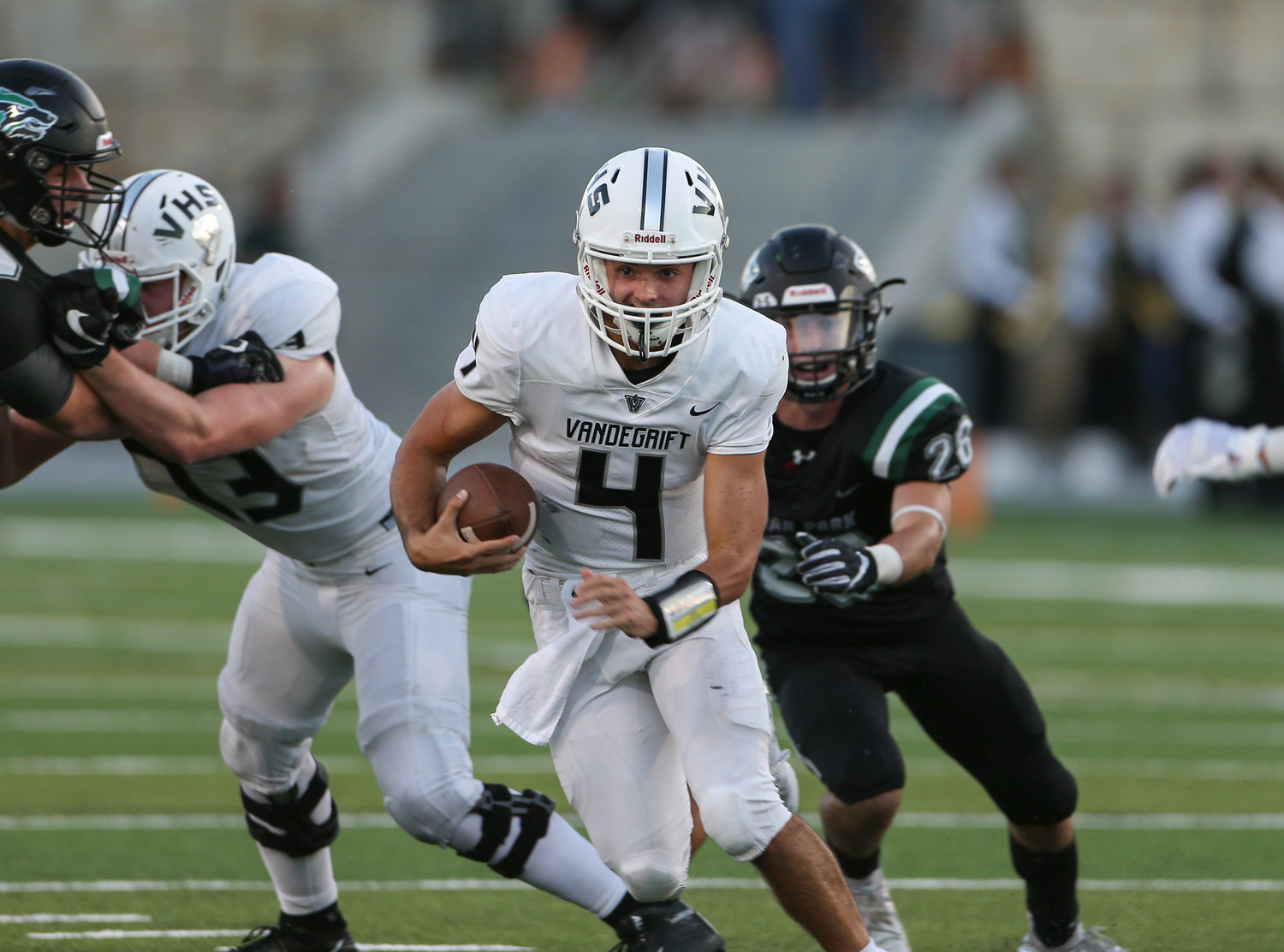 Vandegrift Vipers junior quarterback Dru Dawson (4)  carries the ball during a high school football game between the Cedar Park Timberwolves and the Vandegrift Vipers on Friday, Aug. 31, 2018 in Cedar Park, Texas.