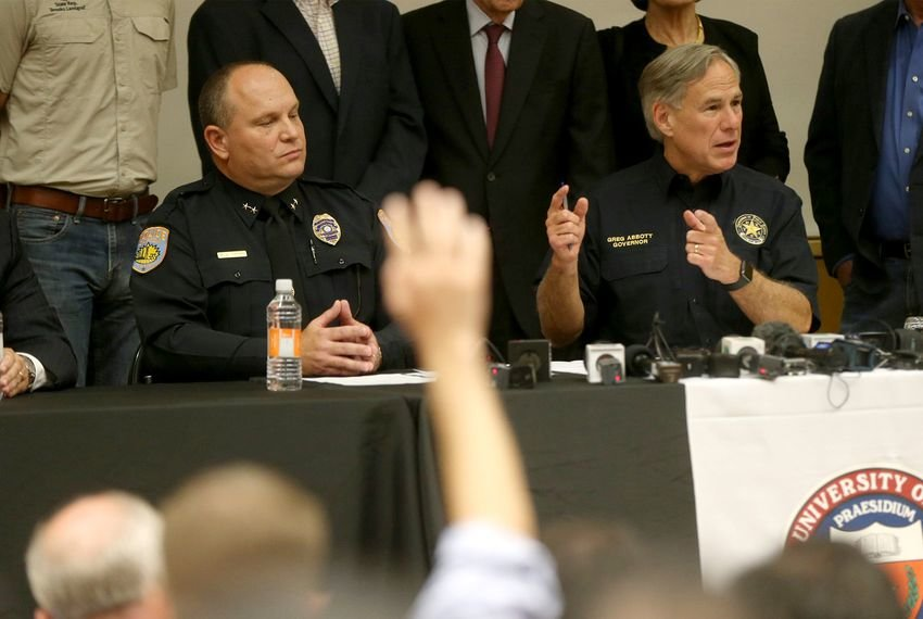 Gov. Greg Abbott appeared at a Sunday press conference with Odessa's police chief a day after a mass shooting in Midland and Odessa.