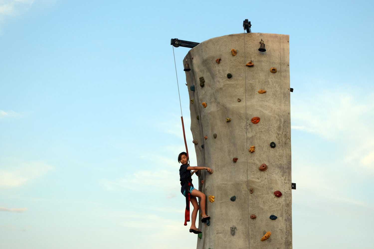 Clara Chung, 10, almost makes it to the top of the rock wall.