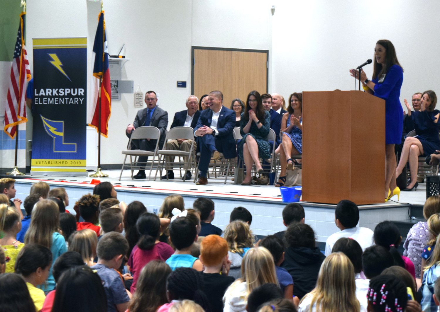 Larkspur Elementary Principal Tracie Montanio spoke to students, parents, faculty and Leander Independent School Board members at the school's dedication ceremony on Friday.