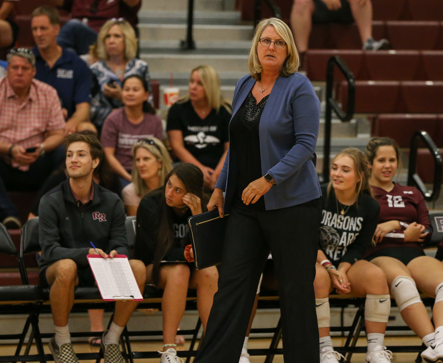 Round Rock Dragons head coach Diane Watson during a high school volleyball match between Round Rock and the Vandegrift at Round Rock High School in Round Rock, Texas on September 3, 2019.