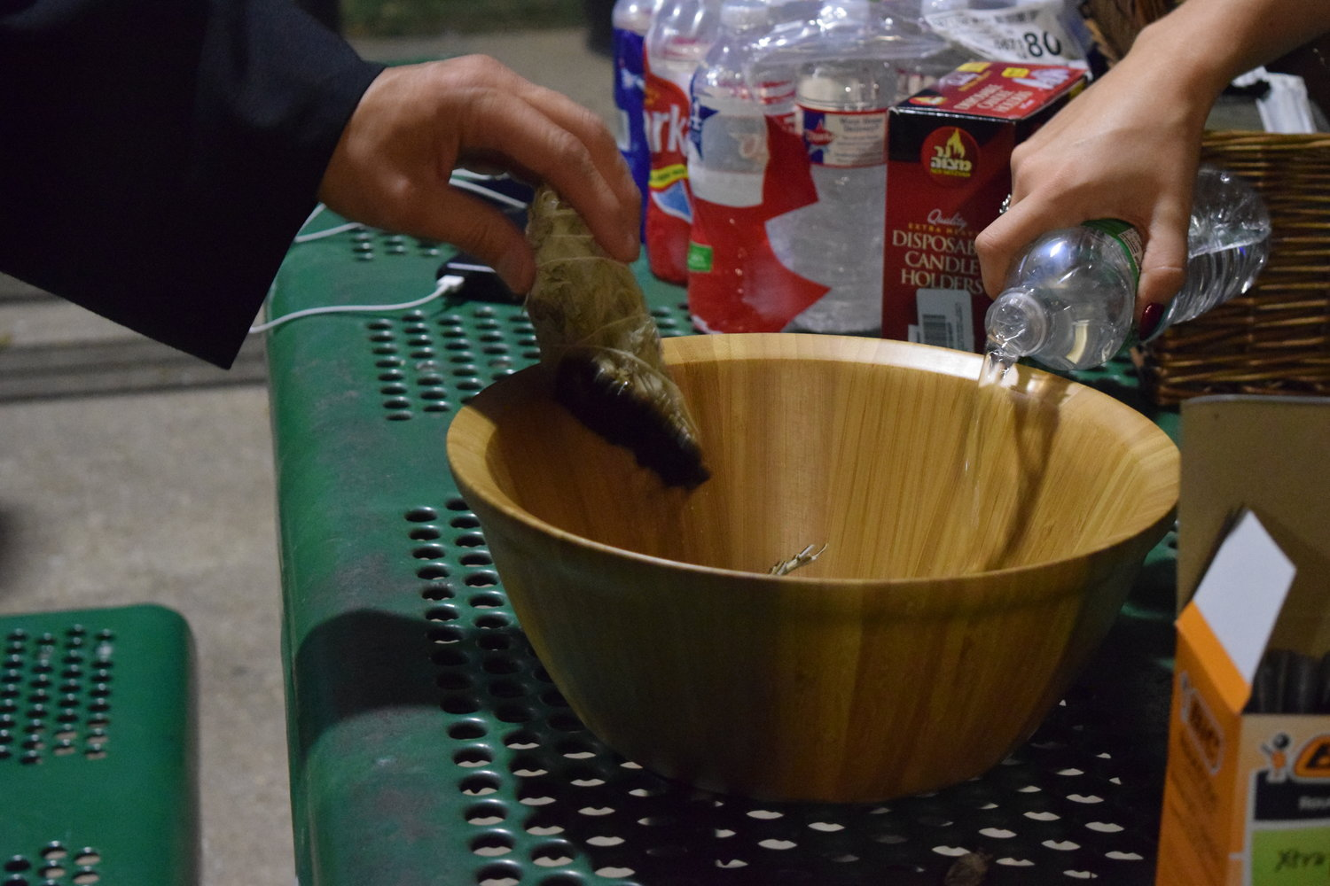 Activists put burning sage out in a communal bowl at the event.