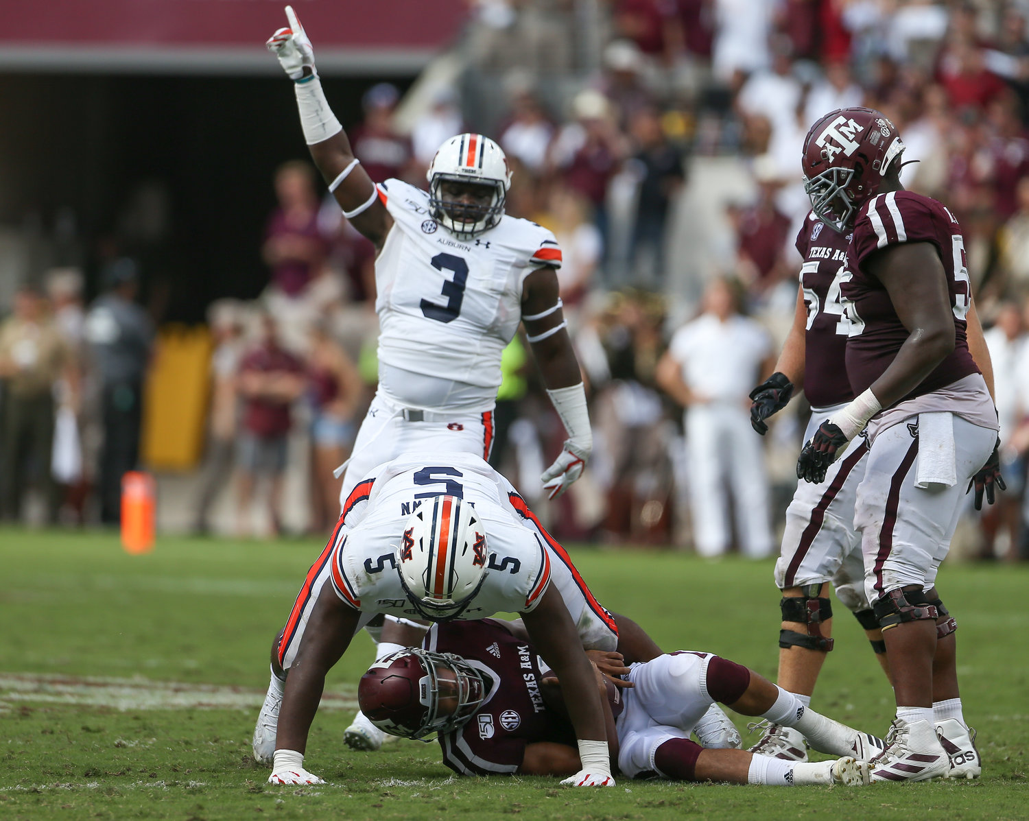 Auburn Tigers defensive end Marlon Davidson (3) celebrates after defensive tackle Derrick Brown (5) sacks Texas A&M Aggies quarterback Kellen Mond (11) during an NCAA football game between Texas A&M and Auburn at Kyle Field in College Station, Texas, on September 21, 2019.