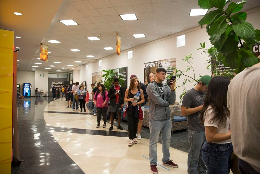 Voters line up to cast their ballot at the LBJ Student Center at Texas State University in November 2018.