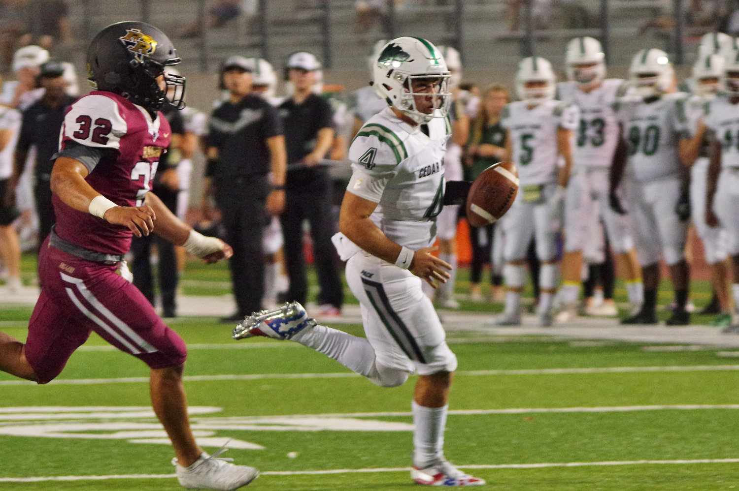 Cedar Park Timberwolves quarterback Ryder Hernandez (4) rolls left for a touchdown early in the the 3rd quarter against the Rouse Raiders at Bible Stadium, Leander, Texas on September 27th, 2019.