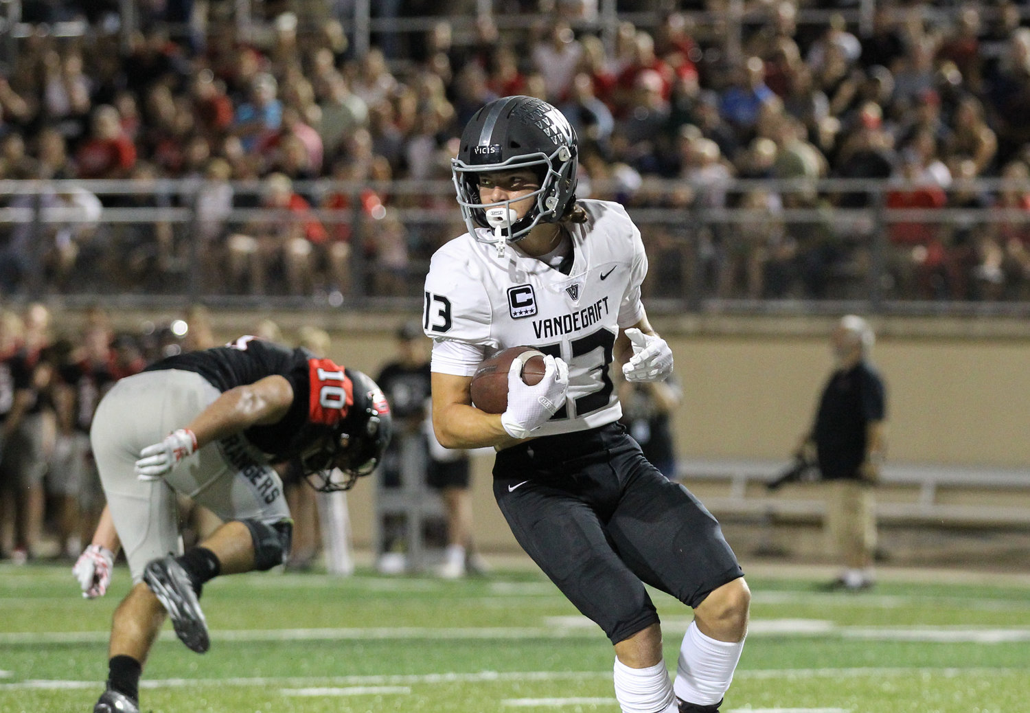 Vandegrift Vipers senior wide receiver Trey Mongauzy (13) scores on a touchdown catch during a high school football game between Vista Ridge and Vandegrift at Gupton Stadium in Cedar Park, Texas, on Sept. 27, 2019.