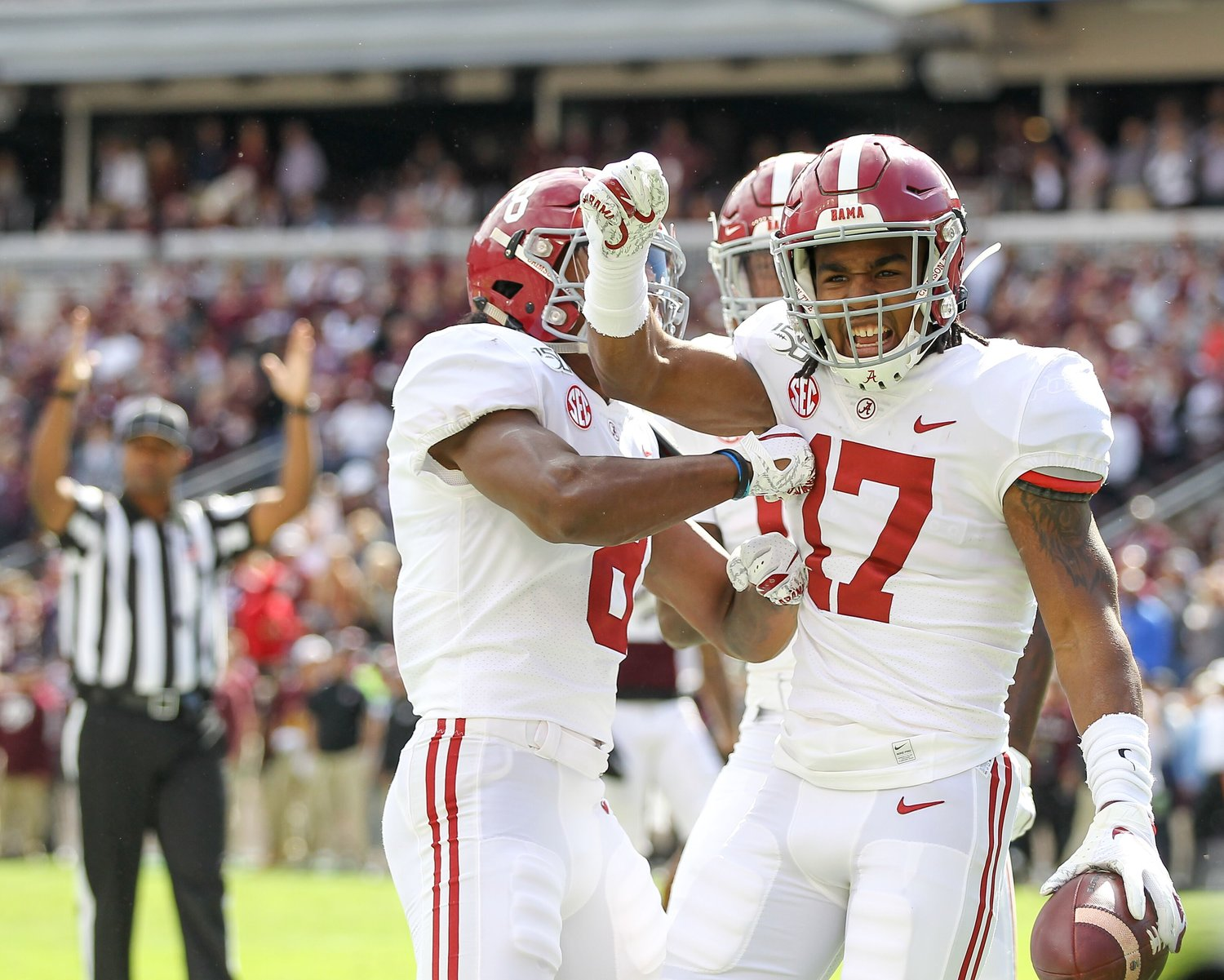 Alabama's Jaylen Waddle celebrates in the end zone following a first quarter touchdown Saturday.