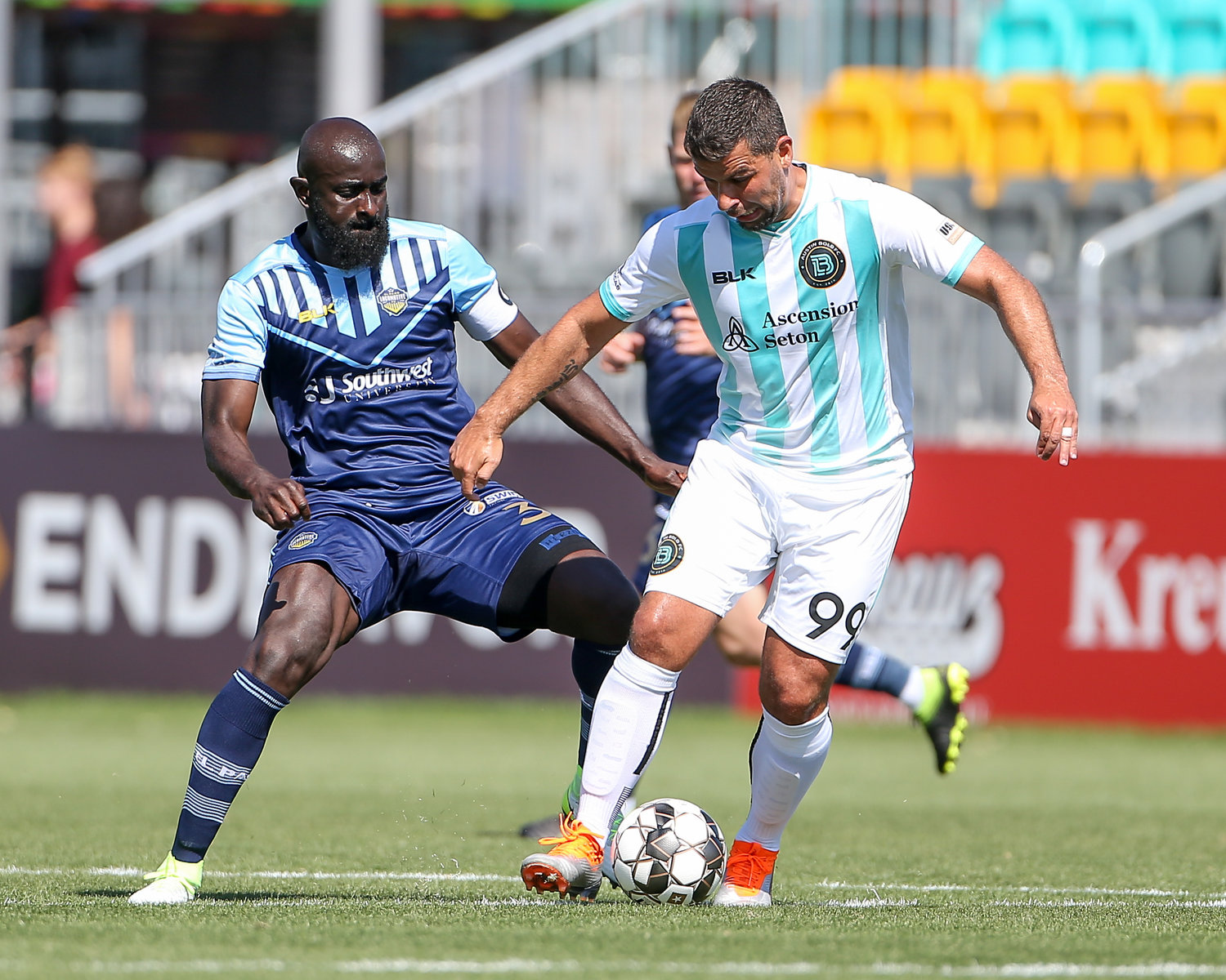 Austin Bold FC forward André Lima (99) works against El Paso Locomotive FC defender Chiró N'Toko (3) during a United Soccer League game between Austin Bold FC and El Paso Locomotive FC on April 21, 2019 at Bold Stadium in Austin, Texas.