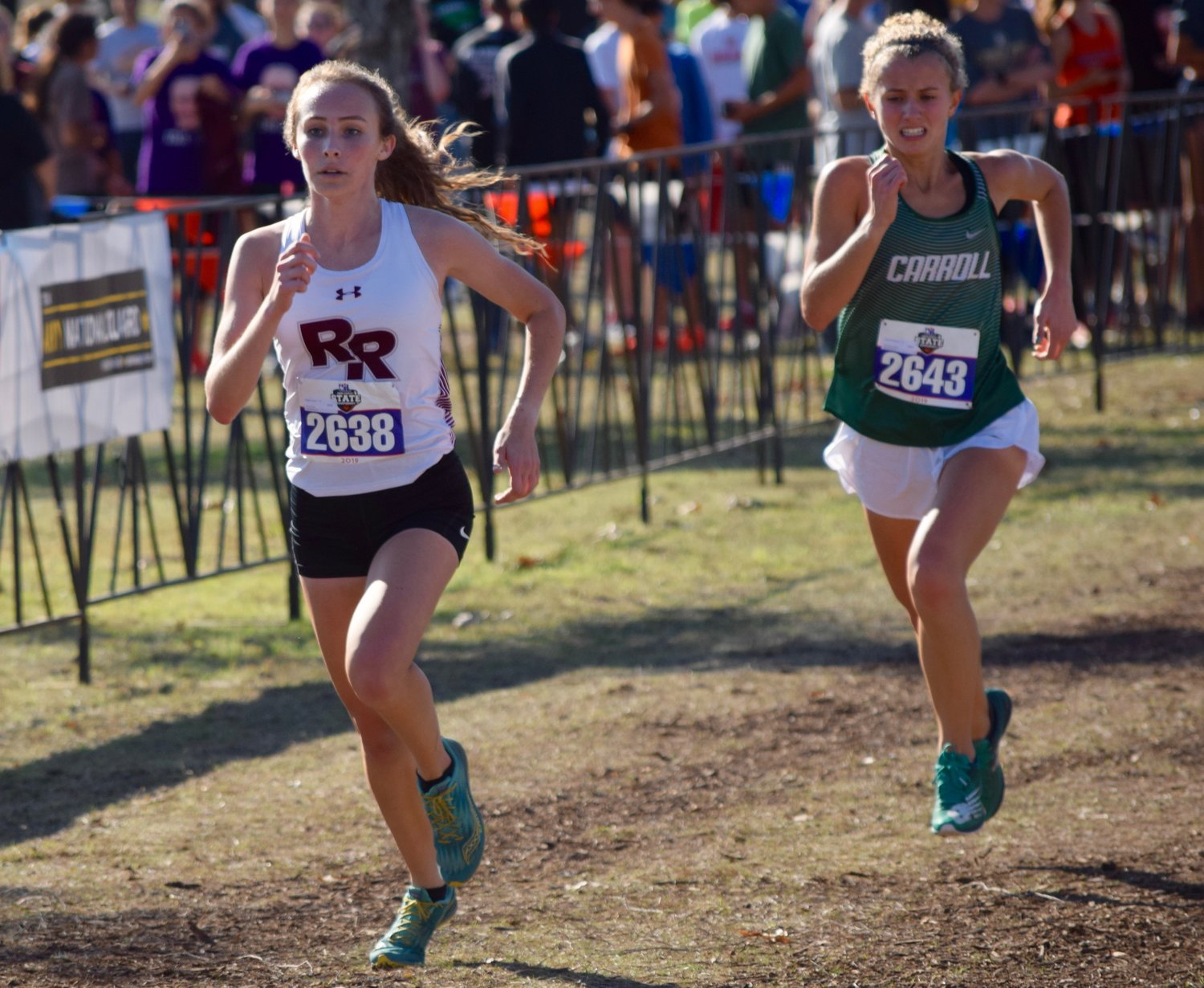 Round Rock runner Megan Nevlud, left, finished with a time of 18:14.29 at the state cross country meet Saturday at Old Settlers Park in Round Rock.