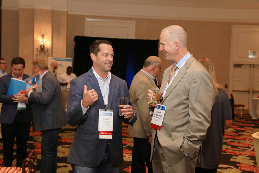 Kevin Craig, left, AMG/Parade's senior vice president and director of the newspaper relations group, talks with Tom Ratkovich, managing director of LEAP Media Solutions at a reception during  last year's Annual Meeting in Colorado Springs.