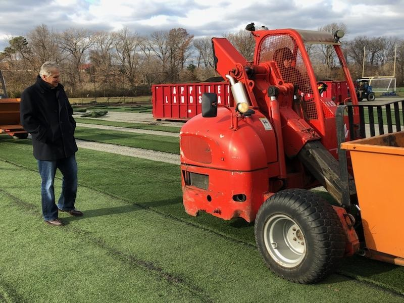 Essex County Executive Joseph N. DiVincenzo, Jr. watches as the old synthetic grass surface is removed from the Roberto Clemente Field in the Essex County Branch Brook Park Middle Division on Thursday, November 29th. The field will be modernized with a new synthetic grass surface. The improvements are part of the County Executive's ongoing initiative to ensure recreation facilities are up to date and meet the needs of the community. (Photo courtesy of Essex County)