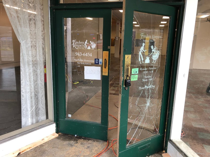 The old Finders Keepers storefront, one of the businesses to have the front windows smashed by vandals this week, stands empty with still-cracked windows Wednesday morning.