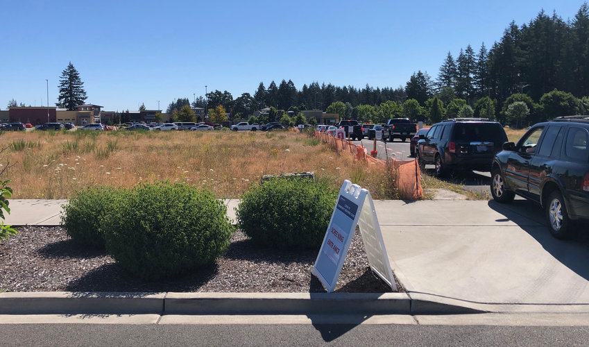 Providence Medical Group drive-through COVID-19 Testing:  In this image, from July 2020, some 30 cars reach from the driveway entrance to the cotton swab.