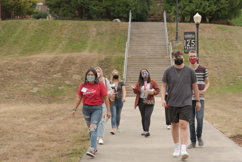 A group of St. Martin's University students roam the campus during the fall semester's move-in week.