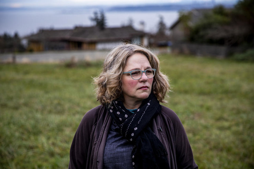Cheryl Richmond near her home on Vashon Island on Dec. 7, 2020. Richmond saw her car insurance nearly double recently due to a drop in her credit score after missing two mortgage payments. She lost her job in February and, like most people, has been struggling to pay her bills during the pandemic. Washington Insurance Commissioner Mike Kreidler is proposing legislation that would cut the tie between credit scores and insurance rates, which would help ensure people like Richmond, who are struggling financially during the COVID-19 crisis, won't owe more money on their insurance.