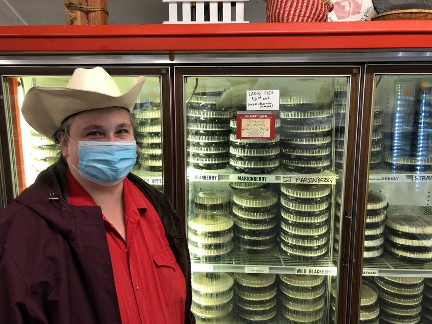 Debbie Lattin, bakery manager at Lattin's Country Cider Mill & Farm, in front of some of the 24 varieties of fruit pies produced there, on January 13, 2021.