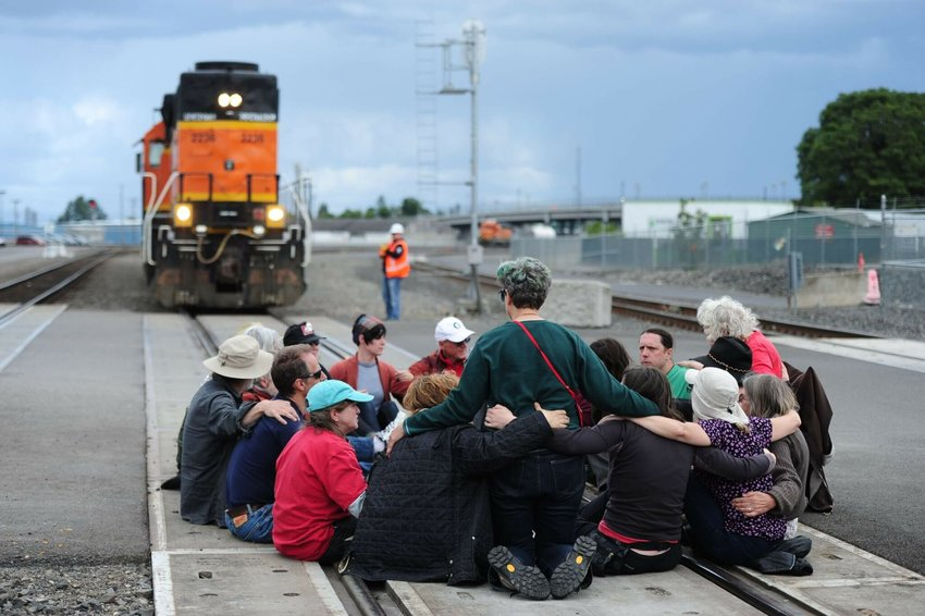 Cascadian activists have in some cases employed civil disobedience tactics in their fight to keep the region from becoming a major export center for planet-warming fossil fuels. Here, protesters block the main BNSF rail line in Vancouver, Washington, on June 18, 2016, as police begin to move in. The action was organized by the Fossil Fuel Resistance Network in response to a recent oil train derailment in Mosier, Oregon, to highlight the risks of fossil fuel transportation.