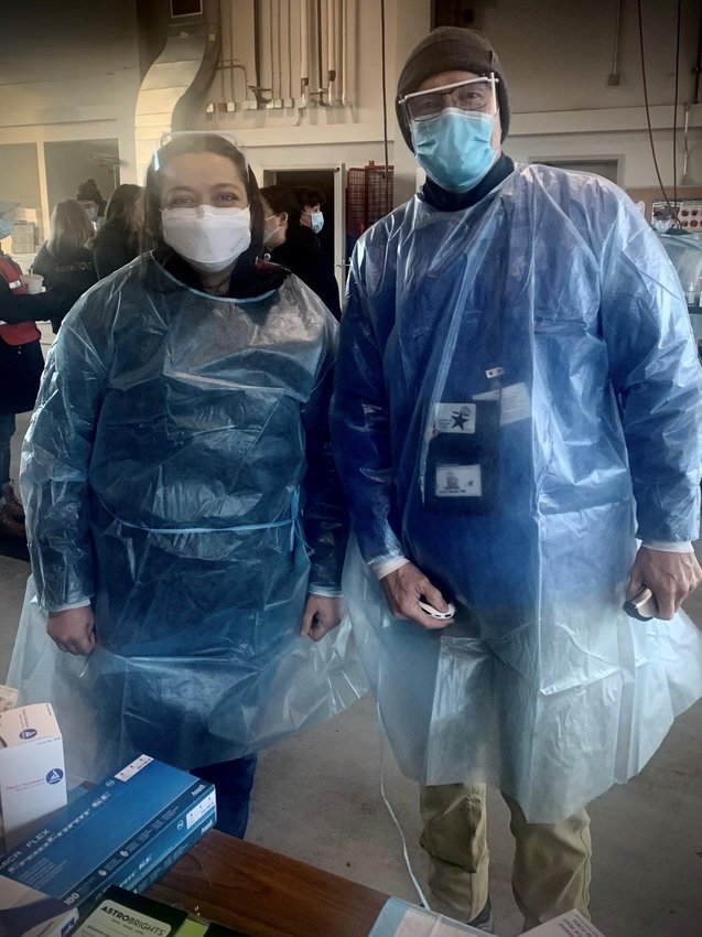 Thurston County Health Officer Dr. Dimyana Abdelmalek (left) and Medical Reserve Corps Physician Dr. Britt Smith (right) prepare to vaccinate patients on Mar. 6, 2021.