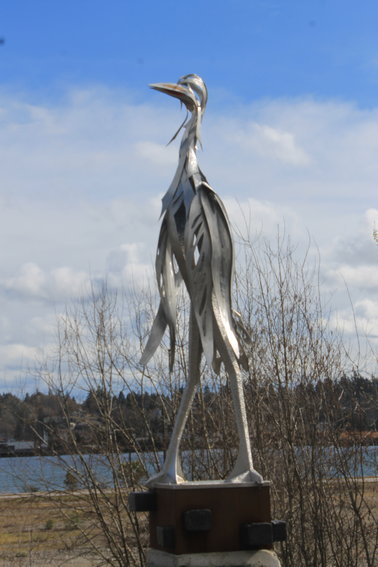 This steel sculpture of a heron looks toward the property on West Bay Drive that would be developed under a recent proposal.